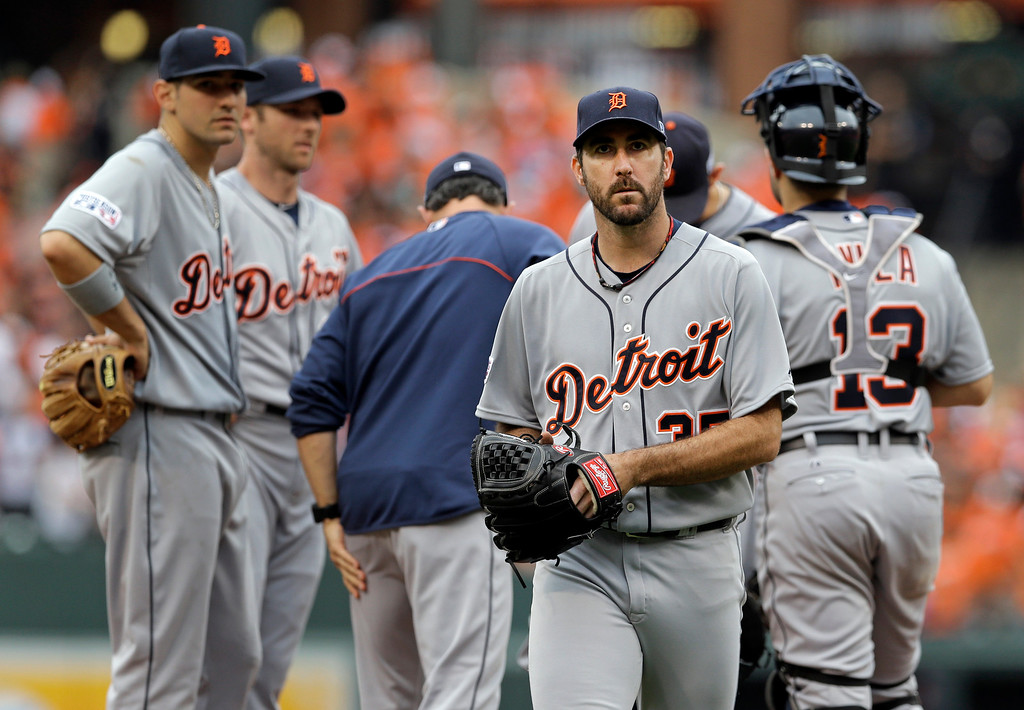 . Detroit Tigers starting pitcher Justin Verlander, front, walks off the field after being relieved in the sixth inning of Game 2 in baseball\'s AL Division Series against the Baltimore Orioles in Baltimore, Friday, Oct. 3, 2014. (AP Photo/Patrick Semansky)