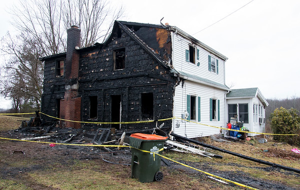 02/10/20 Wesley Bunnell | Staffrr960 East Johnson Ave. in Southington where an overnight fire occurred into the early hours of Monday morning. A view of the blackened front section of the home.