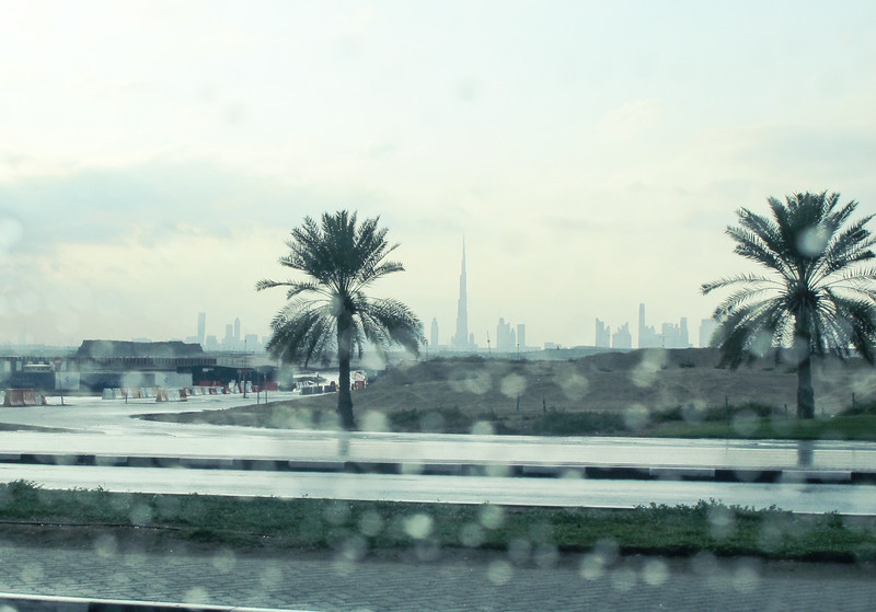 The charm of desert rain and the view of the majestic city with the Burj Khalifa in the distance