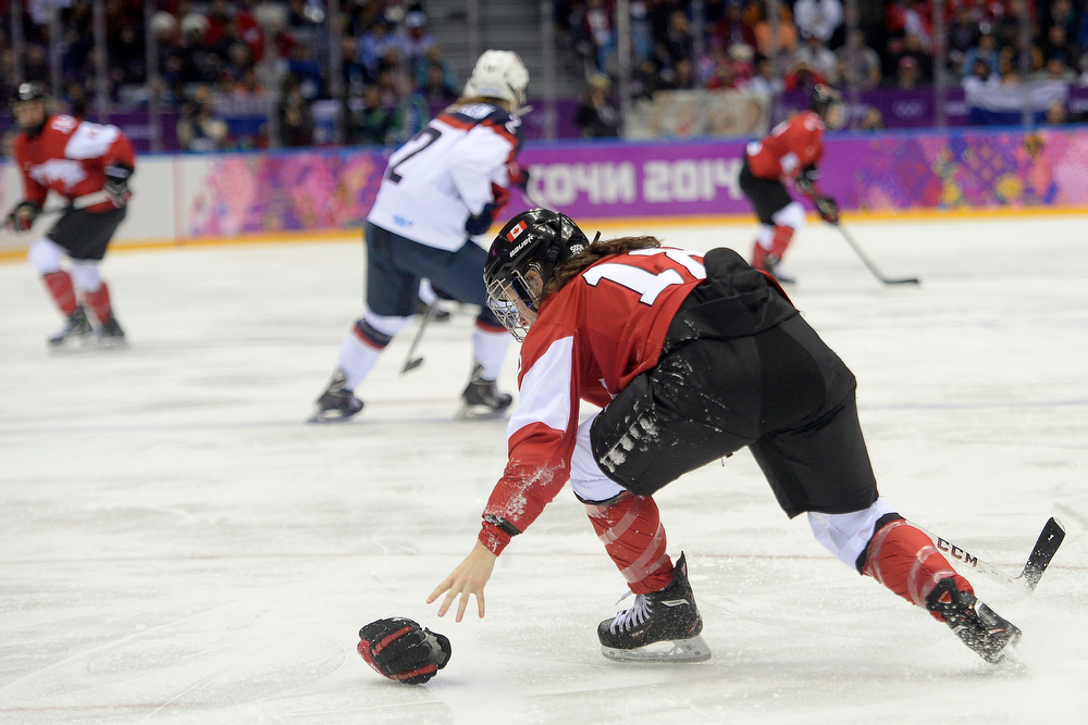 . Catherine Ward (18) of the Canada loses her glove against the U.S.A. during the second period of the women\'s gold medal ice hockey game. Sochi 2014 Winter Olympics on Thursday, February 20, 2014 at Bolshoy Ice Arena. (Photo by AAron Ontiveroz/ The Denver Post)