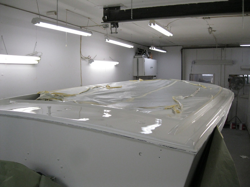 Rear starboard view of boat completly painted.