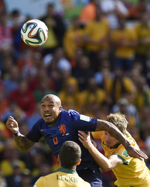 . Netherlands\' midfielder Nigel de Jong (L) heads the ball during a Group B football match between Australia and the Netherlands at the Beira-Rio Stadium in Porto Alegre during the 2014 FIFA World Cup on June 18, 2014.  (JUAN BARRETO/AFP/Getty Images)
