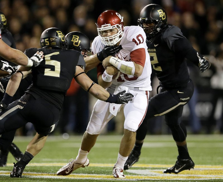 """. <p>3. (tie) OKLAHOMA SOONERS <p>Used to have chunks of teams like Baylor in their stool. (unranked) <p><b><a href=\'http://www.usatoday.com/story/sports/ncaaf/big12/2013/11/07/college-football-baylor-bears-oklahoma-sooners/3471221/\' target=\""""_blank\""""> HUH?</a></b> <p>    (AP Photo/Tony Gutierrez)"""