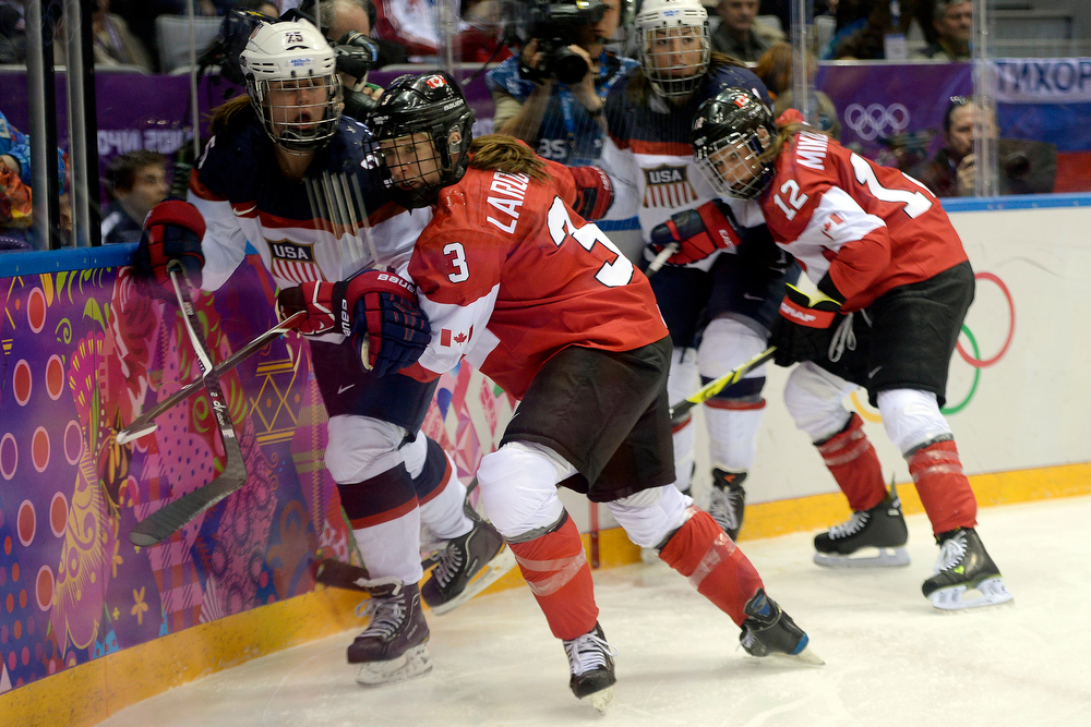 . Jocelyne Larocque (3) of the Canada defends Alex Carpenter (25) of the U.S.A. during the first period of the women\'s gold medal ice hockey game. Sochi 2014 Winter Olympics on Thursday, February 20, 2014 at Bolshoy Ice Arena. (Photo by AAron Ontiveroz/ The Denver Post)