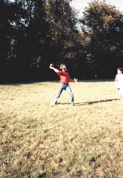 John throws a pass