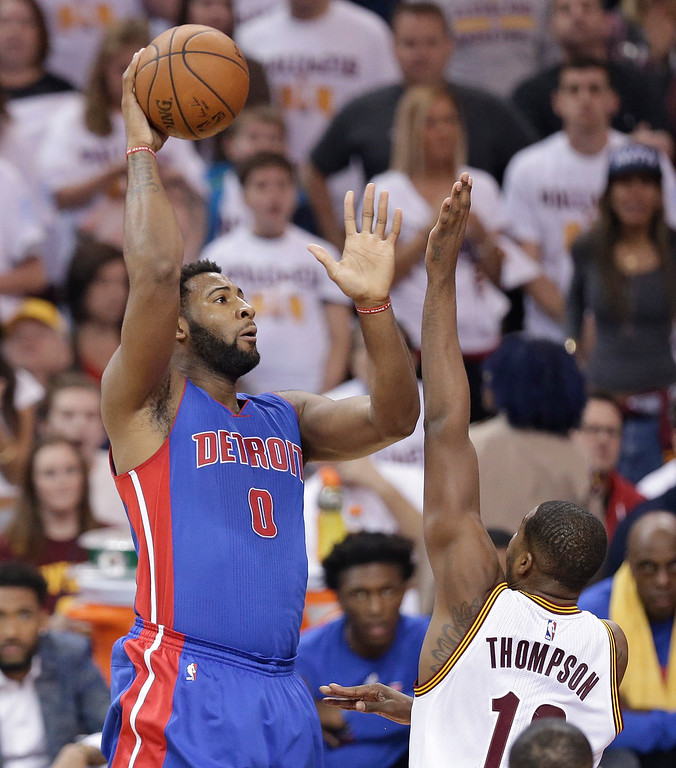 . Detroit Pistons\' Andre Drummond (0) shoots over Cleveland Cavaliers\' Tristan Thompson (13) in the first half in Game 2 of a first-round NBA basketball playoff series, Wednesday, April 20, 2016, in Cleveland. (AP Photo/Tony Dejak)