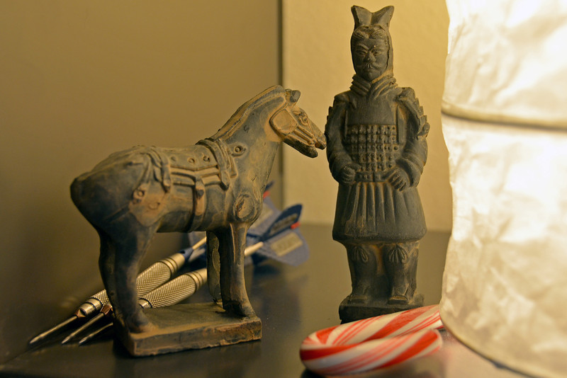 2012-12-14 ––– One of the guys at work, Ryan, spent two weeks in China with one of his friends. He brought back some gifts for all of us in the marketing group. I've never taken a picture of these clay replicas of the terracotta soldier and his horse before so they were perfect for today. I liked the seasonal reference with the candy cane in the photo left over from the work Christmas party.