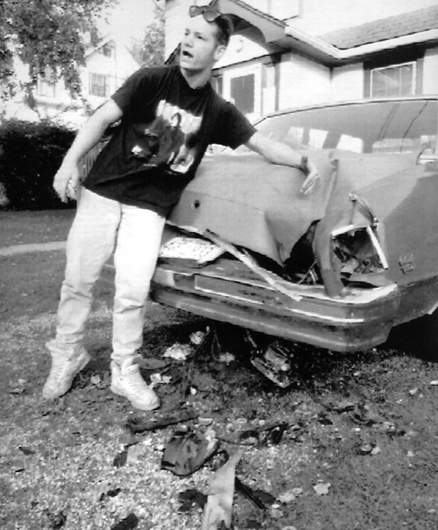 . Michael Aponte explains to curious neighbors, Saturday, how a meteorite struck his girlfriend\'s car and caused extensive damage. Aponte and his girlfriend Michelle Knapp were watching TV inside Knapp\'s home when they heard a loud crash. When investigating they found a football-size meteorite embedded in the ground after it has passed through the trunk of the car. No further details given. (AP Photo/Gannett Suburban/Stuart Bayer)