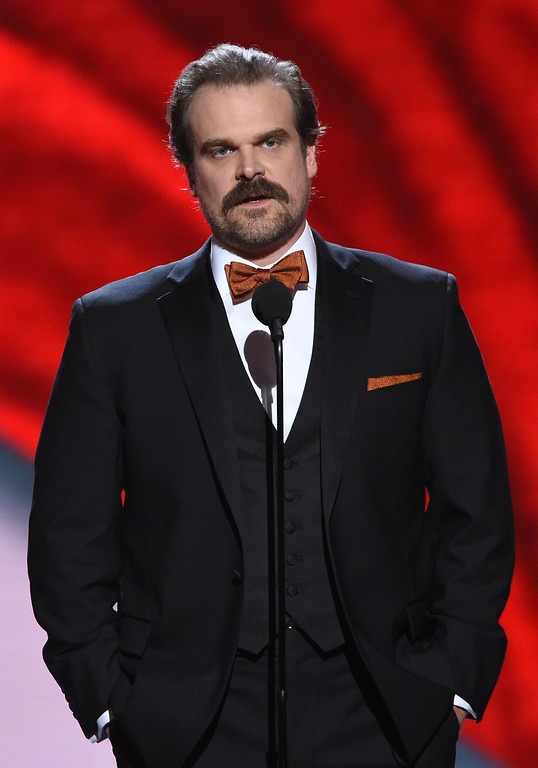 . David Harbour presents the award for best coach at the ESPY Awards at Microsoft Theater on Wednesday, July 18, 2018, in Los Angeles. (Photo by Phil McCarten/Invision/AP)