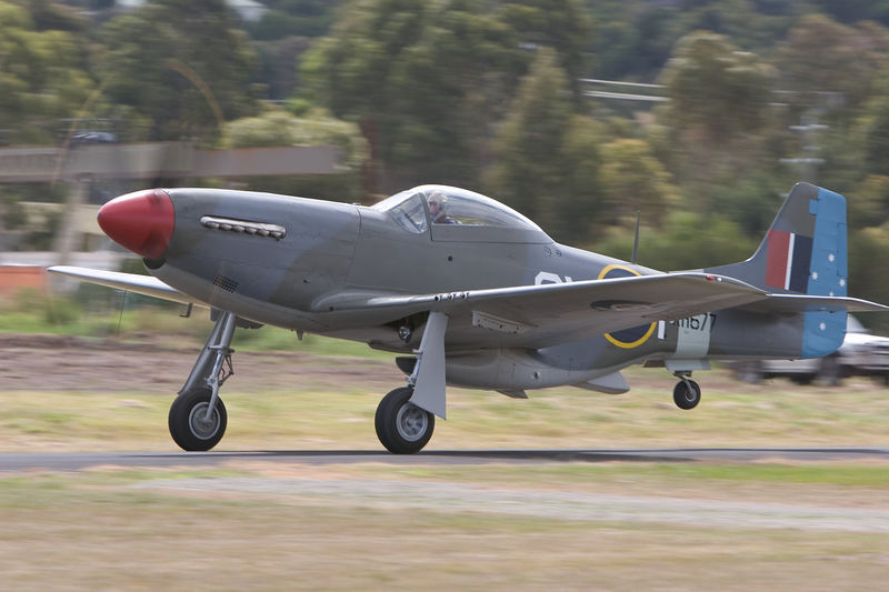 """""""sonorous metal, blowing martial sounds...."""":  wrote John Milton in Paradise Lost. Book 1,line 540.  VH-JUC, CAC-18, Mustang (RAAF serial A68-105)just about to rotate. Almost full-circle prop-blur with a very low shutter speed. Rolls-Royce Merlin at take-off power is music to the ears.  A68-105CA-18 Mk.211430n/aDelivered 1 AD ex CAC on 21/11/47. Stored sucessively at Benalla, Tocumwal, RAAF East Sale & 1 AD. Sold for scrap 23/04/58 and collected by purchaser on 28/04/58, placed in a hangar with A68-119, 193 and 8 Wirraways. Was on display at a Shell garage at Laverton until purchased around 31/10/64. Moorabin Airshow 1999. Registered VH-JUC from 12/04/96 and flying as A68-105/CV-P, KH677. The colour scheme is representative of that worn by the RAAF's 3 Sqn aircraft in Italy in 1945. Avalon 2003. Information courtesy www.adf.serials.com.au"""