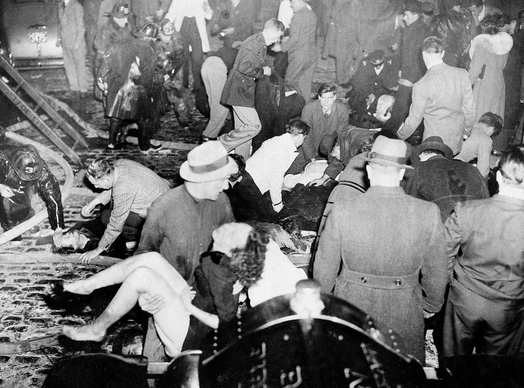 . Survivors of the Cocoanut Grove night club fire in the Back Bay section of Boston are carried out to safety during chaotic rescue efforts, Nov. 28, 1942, during a blaze that took the lives of 492 patrons.  (AP Photo)