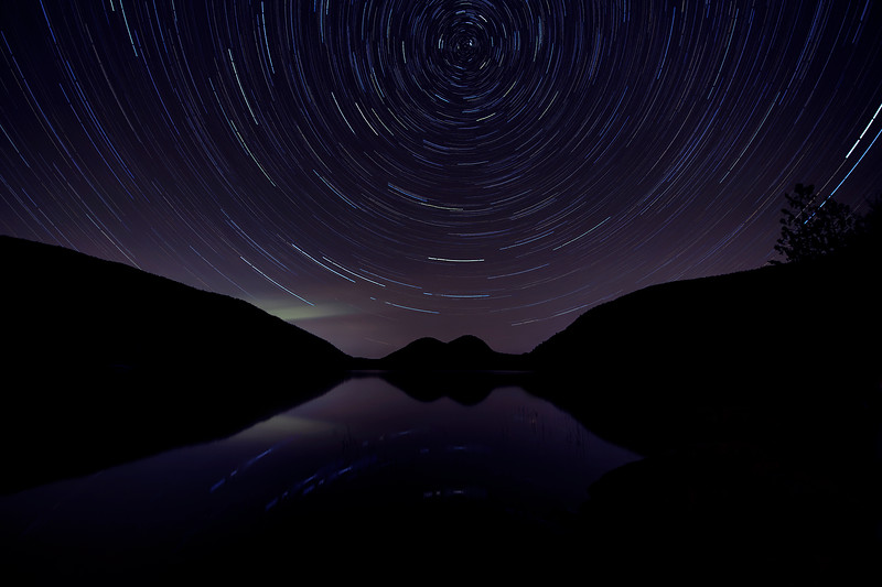 Star trail over The Bubbles at Jordan Pond - Acadia National Park, Maine<br /> <br /> (The light green hue shooting out is a bit of   Aurora Borealis unexpectedly captured.)