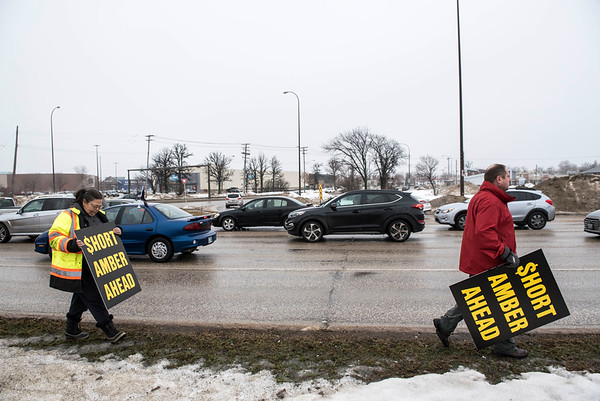 DAVID LIPNOWSKI / WINNIPEG FREE PRESS   Tracy Stahl and Todd Dube of Wise Up Winnipeg brings attention to Bishop Grandin Blvd & St Mary's Rd intersection Sunday January 22, 2017.
