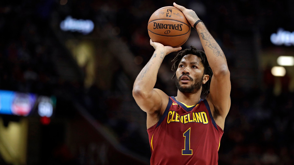 . Cleveland Cavaliers\' Derrick Rose goes to the Utah Jazz. (AP Photo/Tony Dejak)