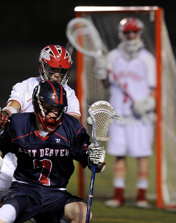 . AURORA, CO. - APRIL 24:  Ken Denver sophomore attack Zander Ellis (7) lost the ball in front of the Raiders net in the second half. The Regis Jesuit High School boy\'s lacrosse team defeated Kent Denver 10-8 Wednesday night, April 24, 2013. Photo By Karl Gehring/The Denver Post