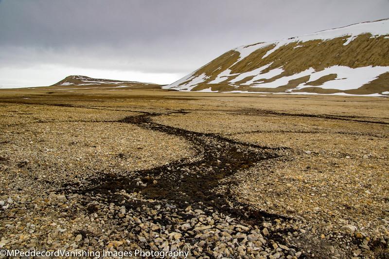 drainage on wide rocky beach