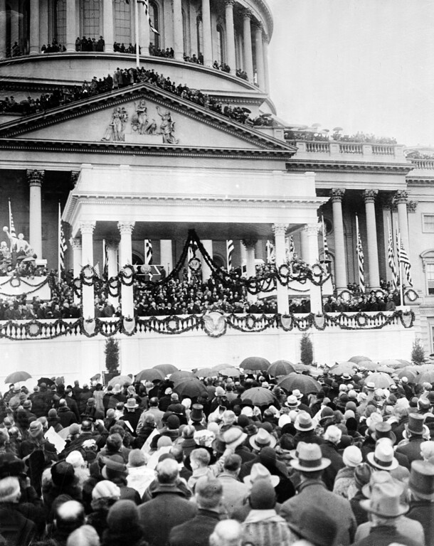 . People stand in the rain for the inauguration of Herbert C. Hoover as he is sworn in as the 31st president of the United States in front of the Capitol in Washington, D.C.,  March 4, 1929.  (AP Photo)