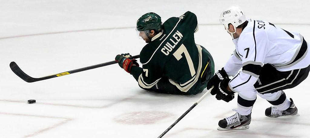 . Minnesota Wild center Matt Cullen (7) looks to pass the puck as he hits the ice as Los Angeles Kings defenseman Rob Scuderi watches during the first period. (Pioneer Press: Sherri LaRose-Chiglo)