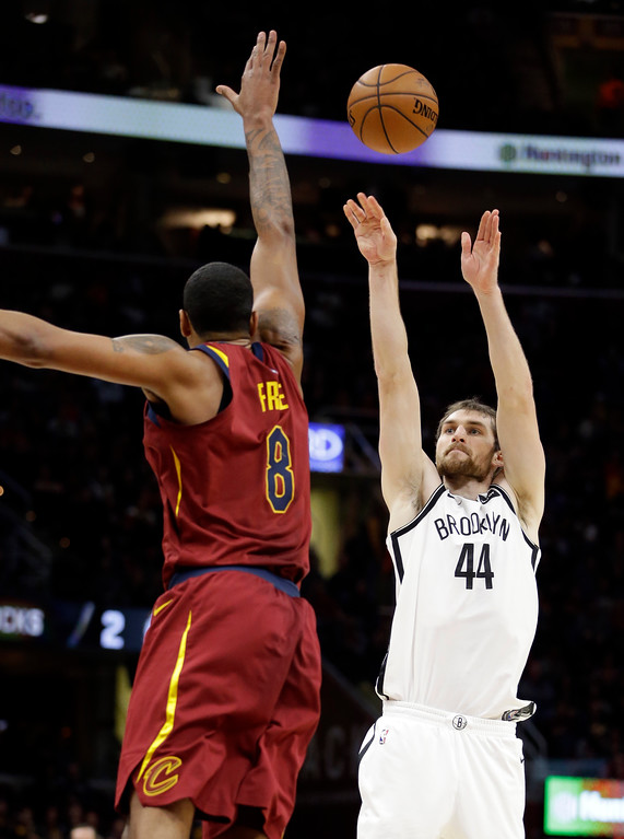 . Brooklyn Nets\' Tyler Zeller (44) shoots over Cleveland Cavaliers\' Channing Frye (8) in the first half of an NBA basketball game, Wednesday, Nov. 22, 2017, in Cleveland. (AP Photo/Tony Dejak)