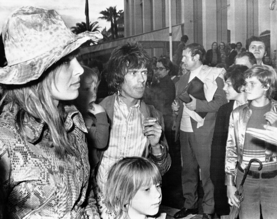 . Keith Richards of The Rolling Stones with his girlfriend Anita Pallenberg and their children as they arrive at Cannes Festival Palace for presentation of US Film �Gimme Shelter� during 25th International Cannes Film Festival in France on May 21, 1971. (AP Photo/Michel Lipchitz)