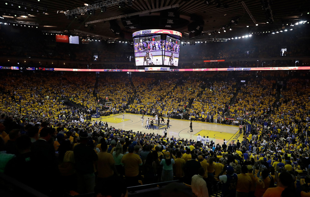 . Fans at Oracle Arena watch the opening tipoff of Game 2 of basketball\'s NBA Finals between the Golden State Warriors and the Cleveland Cavaliers in Oakland, Calif., Sunday, June 4, 2017. (AP Photo/Marcio Jose Sanchez)