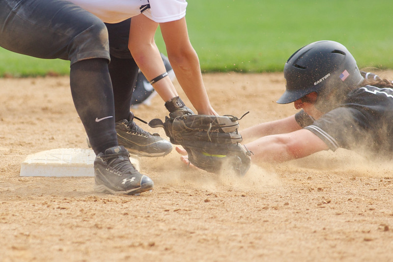 Ashley Burkhardt slides into second base during Purdue's game against the Purdue-Calumet Peregrines.