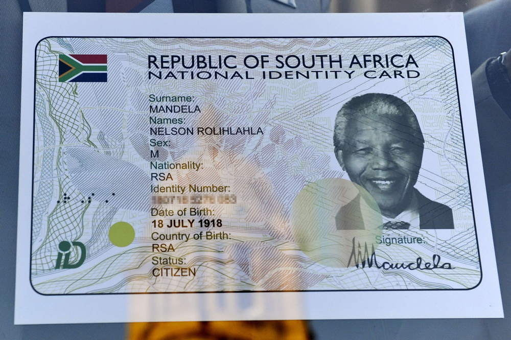 . View dated on July 18, 2013 shows a specimen of former South African President Nelson Mandela\'s Smart ID Card that will be issued to at the Union Buildings in Pretoria on Mandela Day. The official launch of the Smart ID Card by the South African government will take the form of a symbolic handing over of the Smart ID Card to Nelson Mandela, which will be received on his behalf by his daughter Zindzi Mandela.  Preparations for the launch of the Smart ID card, which also coincide with the 50th anniversary of the Rivonia Trial, will witness the handing over of the first batch of Smart ID Cards to senior leaders in and outside government as well as senior citizens of ages ranging between 80-90 years. The launch of the Smart ID Card is part of efforts by the government to consolidate the restoration of national identity, citizenship and dignity that was denied to the majority of South Africans by successive racist regimes.  AFP PHOTO / STRINGERSTRINGER/AFP/Getty Images