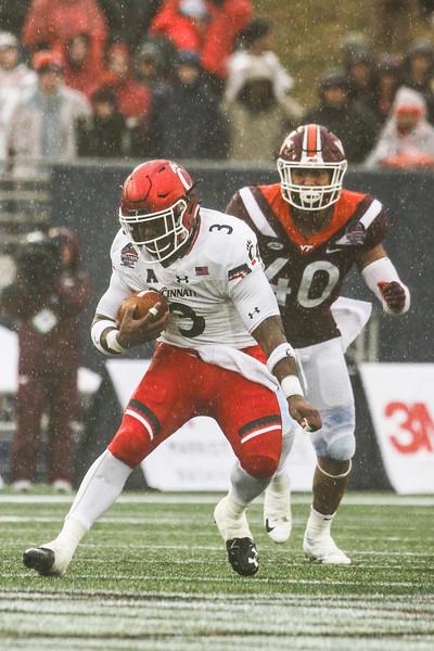 Cincinnati running back #3 Michael Warren II evades Virginia Tech defensive end #40 Emmanuel Belmar