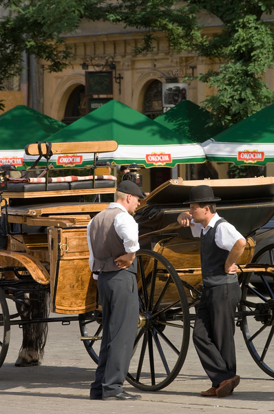 Poland, Cracow, horse drawn carrieges on Rynek Glowny