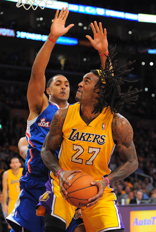 . Lakers Jordan Hill looks for a shot around Ryan Hollins in the NBA season opener between the Lakers and Clippers at Staples Center in Los Angeles, CA on Tuesday, October 29, 2013.   (Photo by Scott Varley, Daily Breeze)