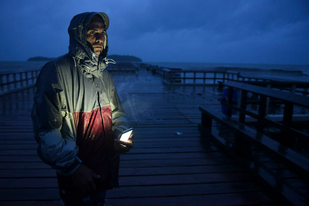 . David Cruz Marrero watches the waves at Punta Santiago pier hours before the imminent impact of Maria, a Category 5 hurricane that threatens to hit the eastern region of the island with sustained winds of 165 miles per hour, in Humacao, Puerto Rico, Tuesday, September 19, 2017. (AP Photo/Carlos Giusti)