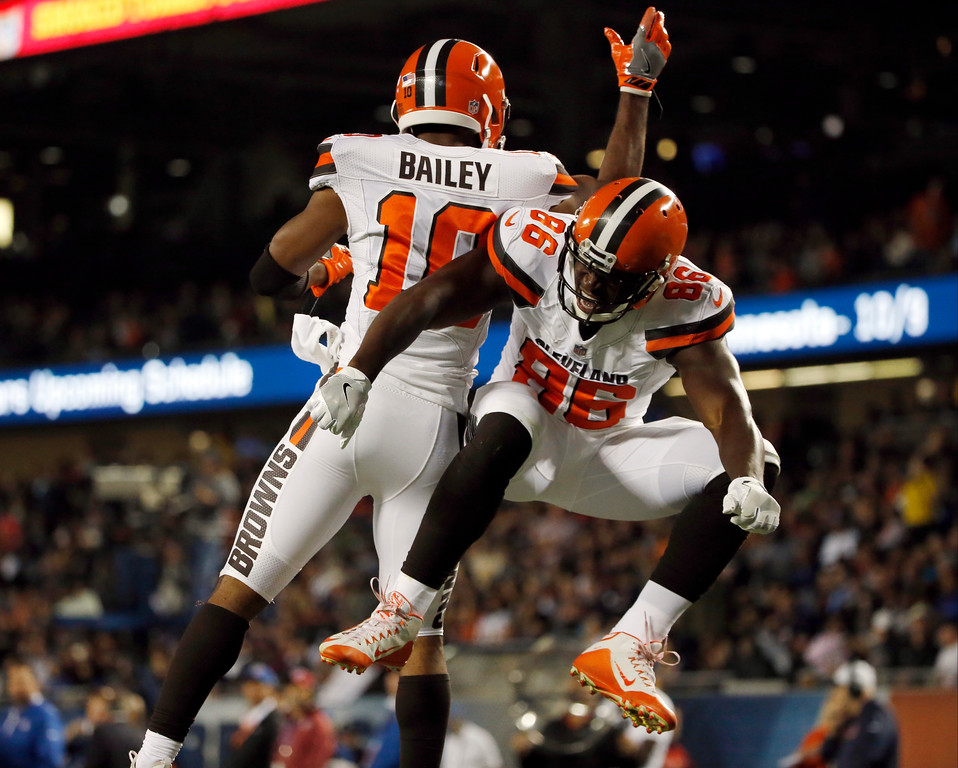 . Cleveland Browns\' Randall Telfer (86) celebrates with Rasheed Bailey (10) after scoring a touchdown during the second half of an NFL preseason football game against the Chicago Bears, Thursday, Aug. 31, 2017, in Chicago. (AP Photo/Nam Y. Huh)