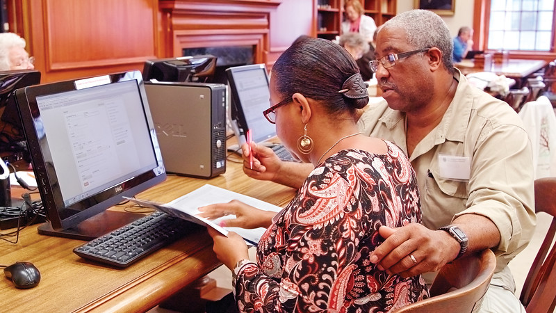 African American couple looking at records. Courtesy of NEHGS