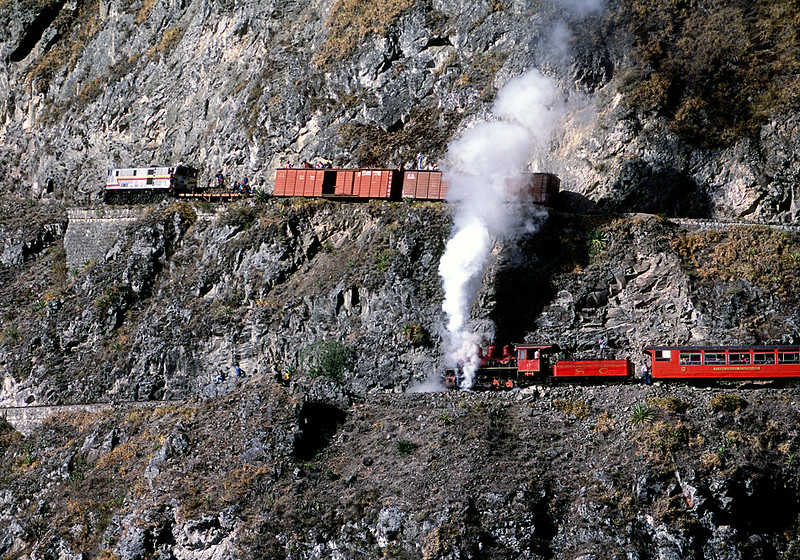 July 2003.  Two trains on the switchbacks at Devils Nose.  SC 17 was in such poor shape it could hardly move itself on the grade.