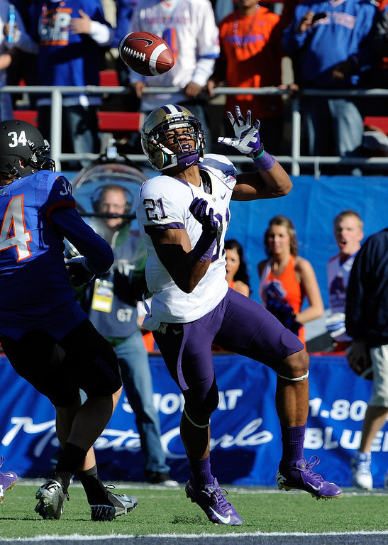 . Washington cornerback Marcus Peters breaks up a reception against Boise State Kirby Moore (34) during first half of the MAACO Bowl NCAA college football game on Saturday, Dec. 22, 2012, in Las Vegas. (AP Photo/David Becker)