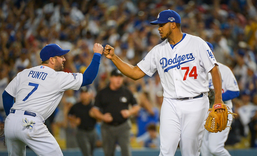 . Dodgers\' Kenley Jansen and Nick Punto celebrate their 3-0 win over  the Cardinals in game 3 of the NLCS series at Dodger stadium Monday, October 14, 2013 ( Photo by Andy Holzman/Los Angeles Daily News )