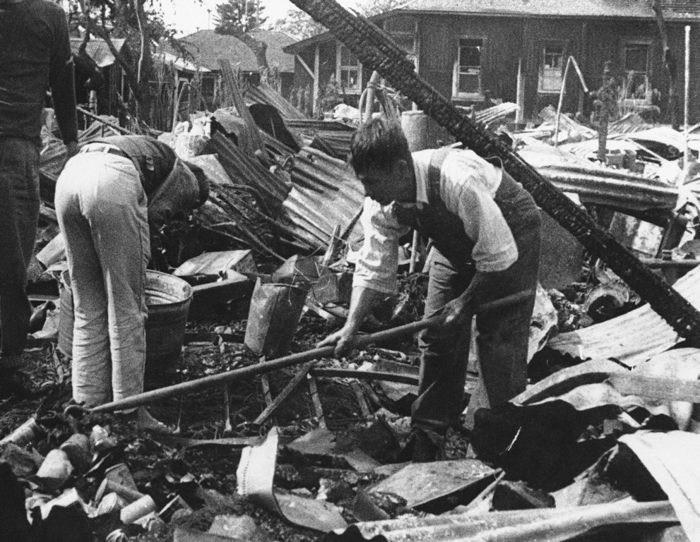 . Hawaii residents comb thru wreckage on Dec. 17, 1941 after Japanese bombing raids on December 7. (AP Photo)