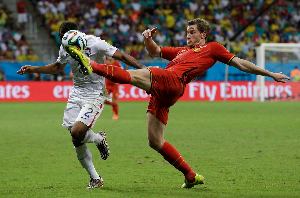 . Belgium\'s Jan Vertonghen, right, clears the ball from United States\' DeAndre Yedlin during the World Cup round of 16 soccer match between Belgium and the USA at the Arena Fonte Nova in Salvador, Brazil, Tuesday, July 1, 2014. (AP Photo/Matt Dunham)