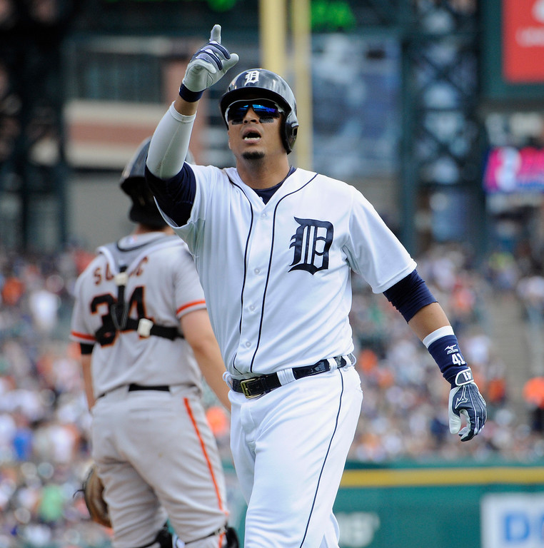 . Detroit Tigers\' Victor Martinez celebrates after hitting a home run against the San Francisco Giants in the first inning of a baseball game Saturday, Sept. 6, 2014, in Detroit, Mich.  AP Photo/Jose Juarez)