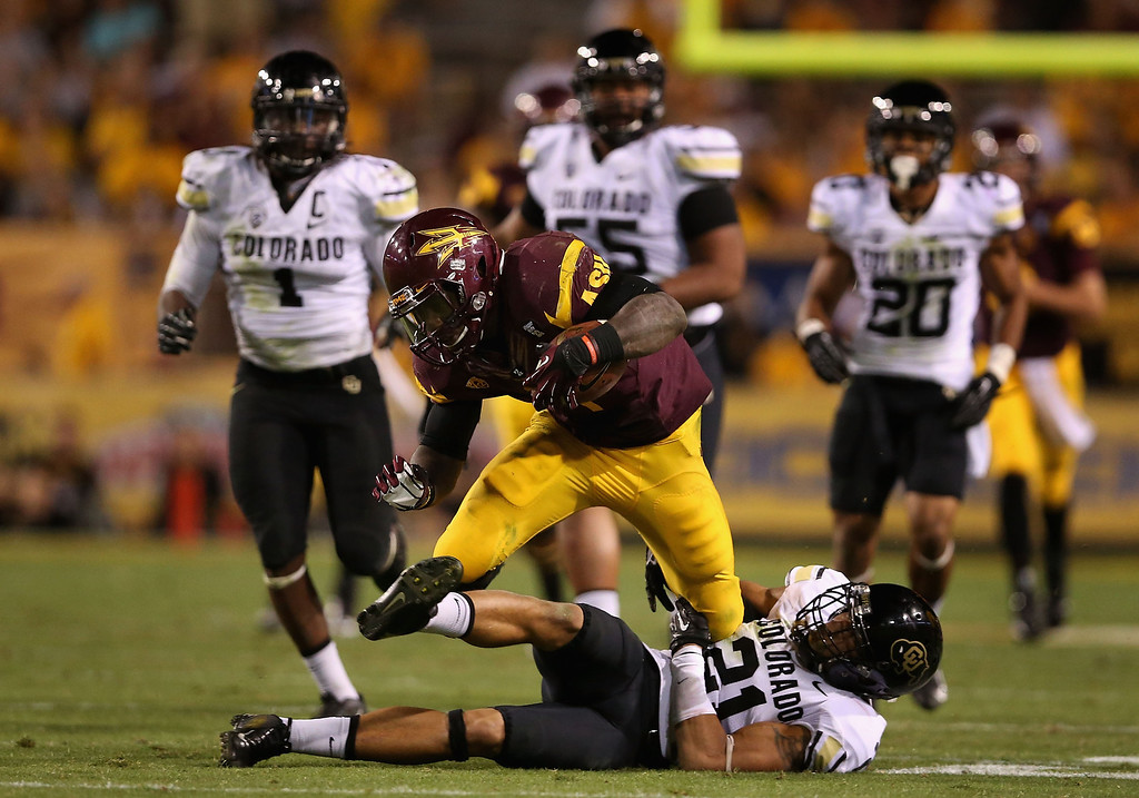 . TEMPE, AZ - OCTOBER 12:  Running back Marion Grice #1 of the Arizona State Sun Devils rushes the football past defensive back Jered Bell #21 of the Colorado Buffaloes during the second quarter of the college football game at Sun Devil Stadium on October 12, 2013 in Tempe, Arizona.  (Photo by Christian Petersen/Getty Images)