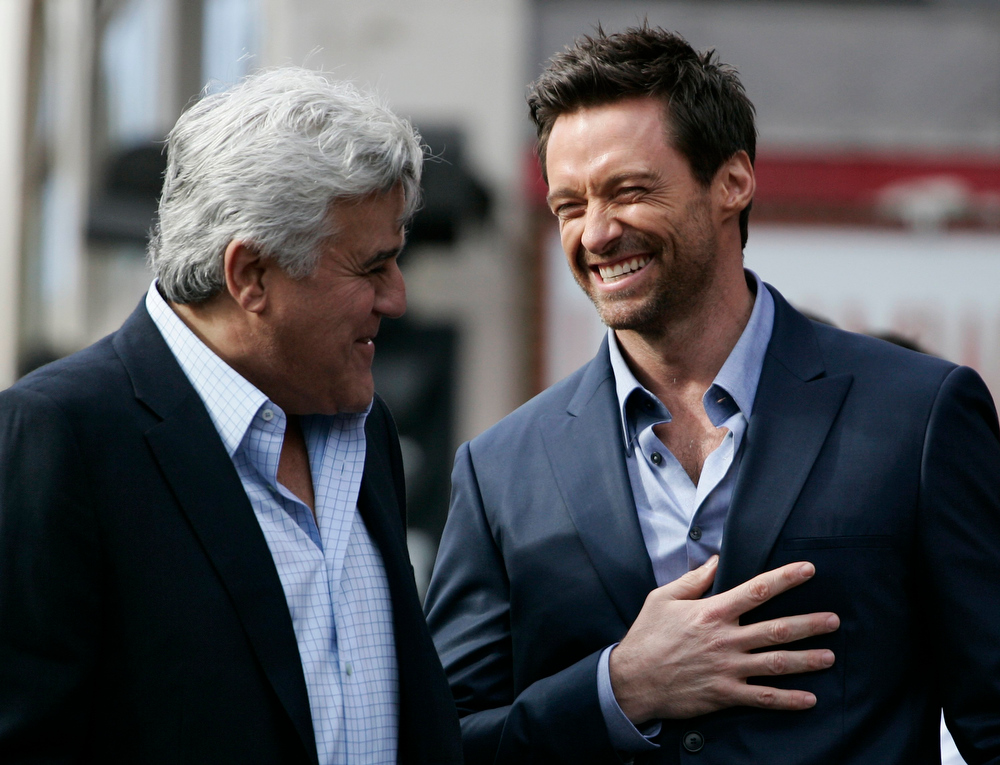 Description of . TV personality Jay Leno (L) and actor Hugh Jackman laugh during ceremonies honoring Jackman with a star on the Hollywood Walk of Fame in Hollywood, California, December 13, 2012. REUTERS/Jonathan Alcorn