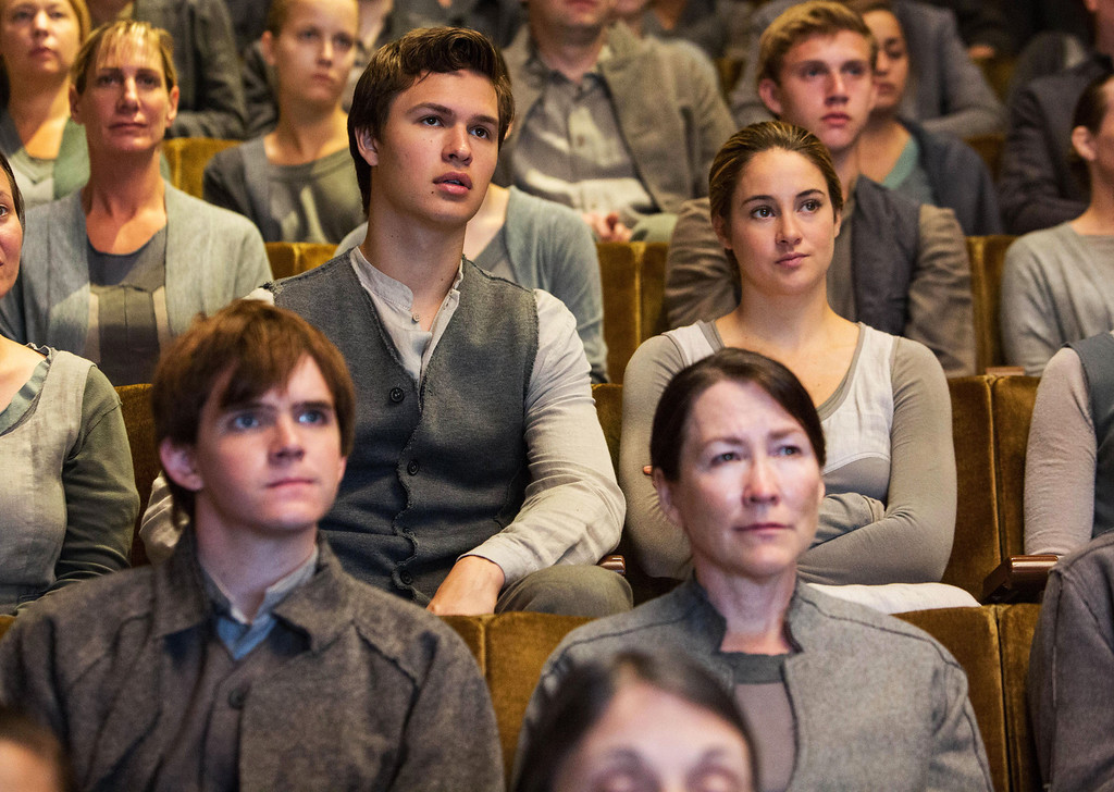 """. This image released by Summit Entertainment shows Ansel Elgort, second row left, and Shailene Woodley, second row right, in a scene from \""""Divergent.\"""" (AP Photo/Summit Entertainment, Jaap Buitendijk)"""