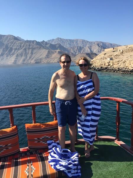 Barbara and Ralph take in a beautiful day on the Musandam Peninsula in Oman - Bridget St. Clair