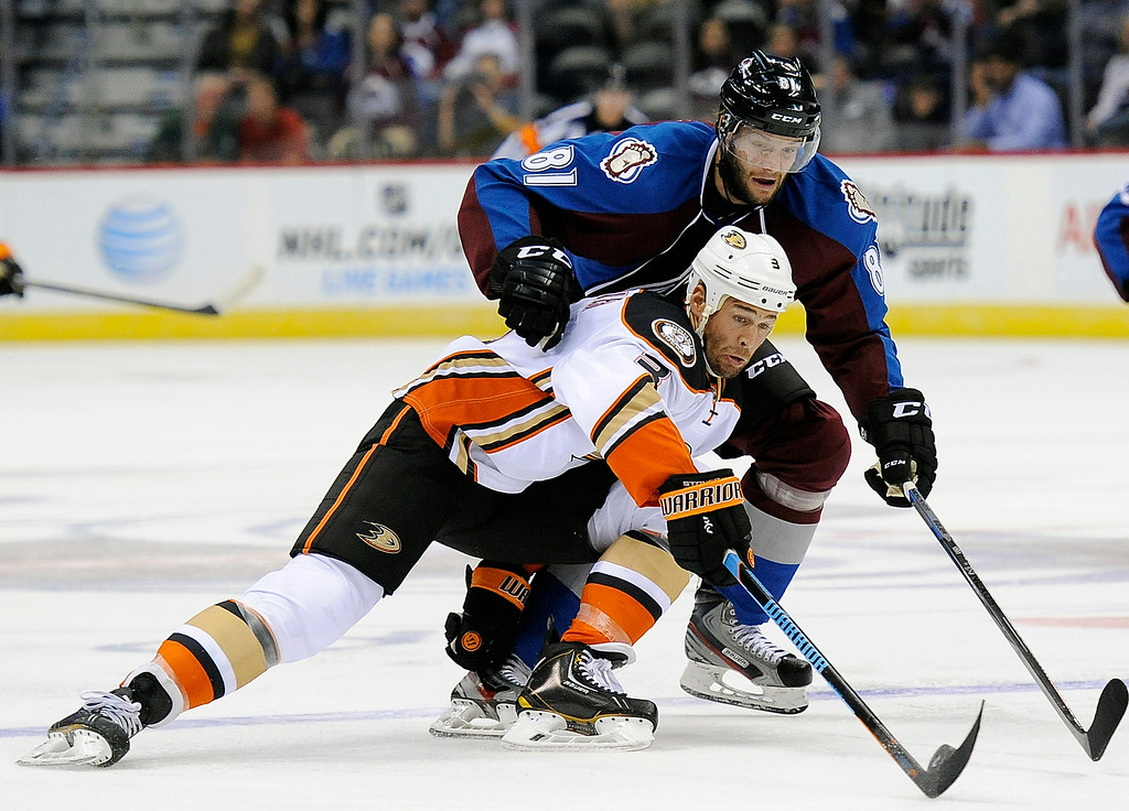 . Anaheim Ducks defenseman Clayton Stoner, bottom, and Colorado Avalanche center Tomas Vincour, top, fight for the puck in the first period of an NHL preseason hockey game Monday, Sept. 22, 2014 in Denver. (AP Photo/Chris Schneider)