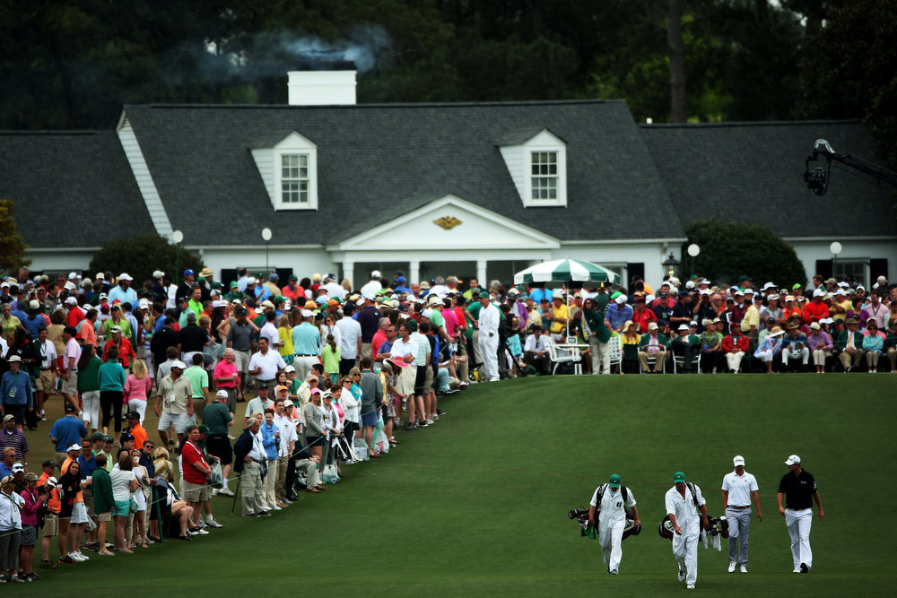Description of . Adam Scott of Australia and Marc Leishman of Australia walk up the first fairway during the final round of the 2013 Masters Tournament at Augusta National Golf Club on April 14, 2013 in Augusta, Georgia.  (Photo by Andrew Redington/Getty Images)