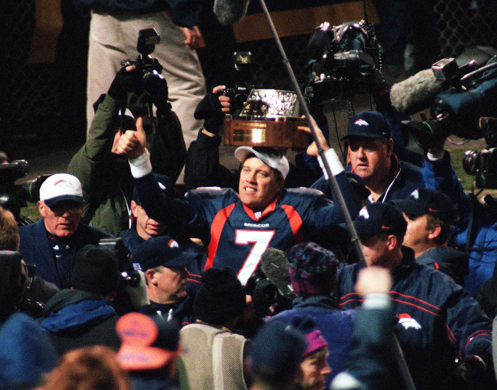 . In John Elway\'s last home game of his career, he completed only 13 of 34 passes. However, running back Terrell Davis, the NFL MVP in 1998, ran for 167 yards and a touchdown as Denver beat the Jets 23-10 in the AFC Championship game.   Denver Broncos John Elway waves to the crowd after the  Broncos beat the New York Jets 23-10 in the AFC Championship.  Photographer: ANDY CROSS/THE DENVER POST