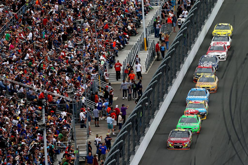 . Jeff Gordon, driver of the #24 Drive To End Hunger Chevrolet, leads a pack of cars during the NASCAR Sprint Cup Series Daytona 500 at Daytona International Speedway on February 24, 2013 in Daytona Beach, Florida.  (Photo by Jonathan Ferrey/Getty Images)