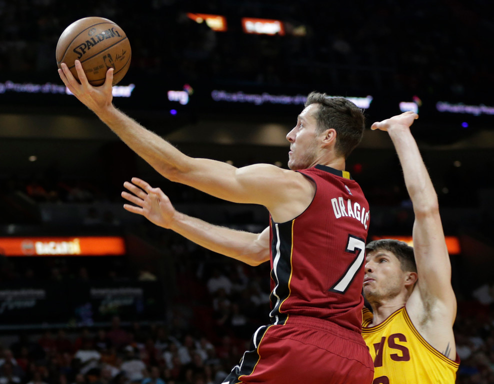 . Miami Heat\'s Goran Dragic (7) drives to the basket as Cleveland Cavaliers\' Kyle Korver defends during the second half of an NBA basketball game, Saturday, March 4, 2017, in Miami. The Heat defeated the Cavaliers 120-92. (AP Photo/Lynne Sladky)