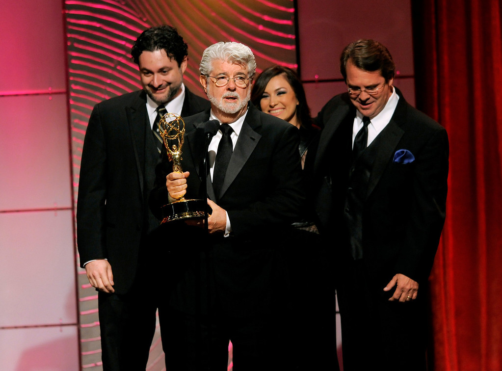""". George Lucas and the crew of \""""Star Wars: The Clone Wars\"""" accept the award for outstanding special class animated program at the 40th Annual Daytime Emmy Awards on Sunday, June 16, 2013, in Beverly Hills, Calif. (Photo by Chris Pizzello/Invision/AP)"""
