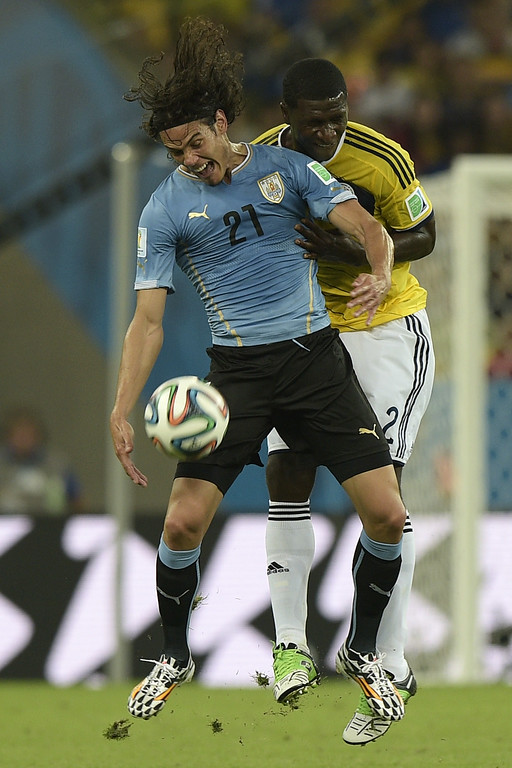 . Uruguay\'s forward Edinson Cavani  (front) and Colombia\'s defender Cristian Zapata vie for the ball during the Round of 16 football match between Colombia and Uruguay at the Maracana Stadium in Rio de Janeiro during the 2014 FIFA World Cup on June 28, 2014. DANIEL GARCIA/AFP/Getty Images